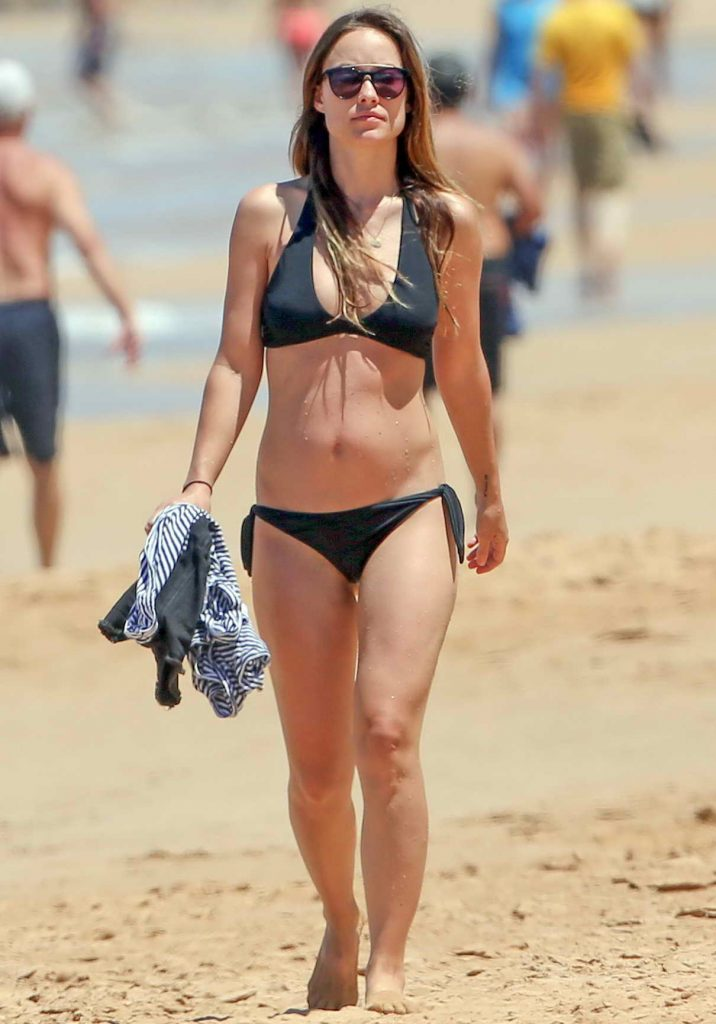 Olivia Wilde in a Black Bikini at the Beach in Hawaii 04/22/2016-1