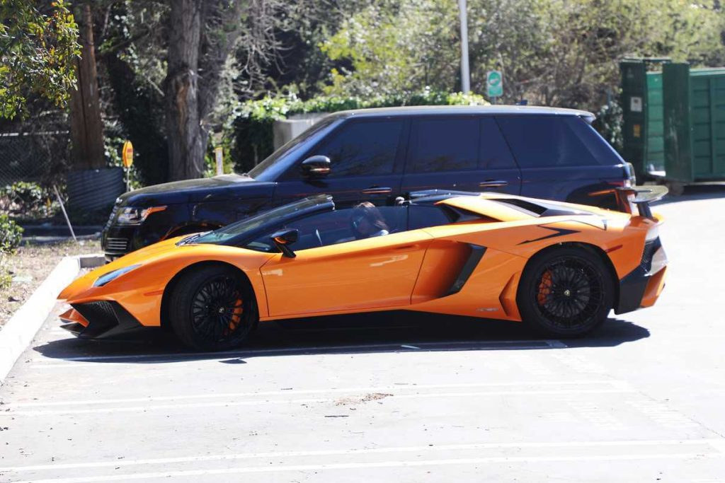 Kylie Jenner Stepping Out of Her Orange Lamborghini in Los Angeles 03/11/2017-1