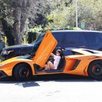 Kylie Jenner Stepping Out of Her Orange Lamborghini in Los Angeles 03/11/2017-2