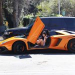 Kylie Jenner Stepping Out of Her Orange Lamborghini in Los Angeles 03/11/2017-3