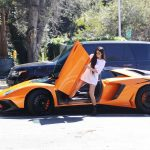 Kylie Jenner Stepping Out of Her Orange Lamborghini in Los Angeles 03/11/2017-4