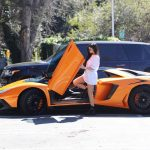 Kylie Jenner Stepping Out of Her Orange Lamborghini in Los Angeles 03/11/2017-5