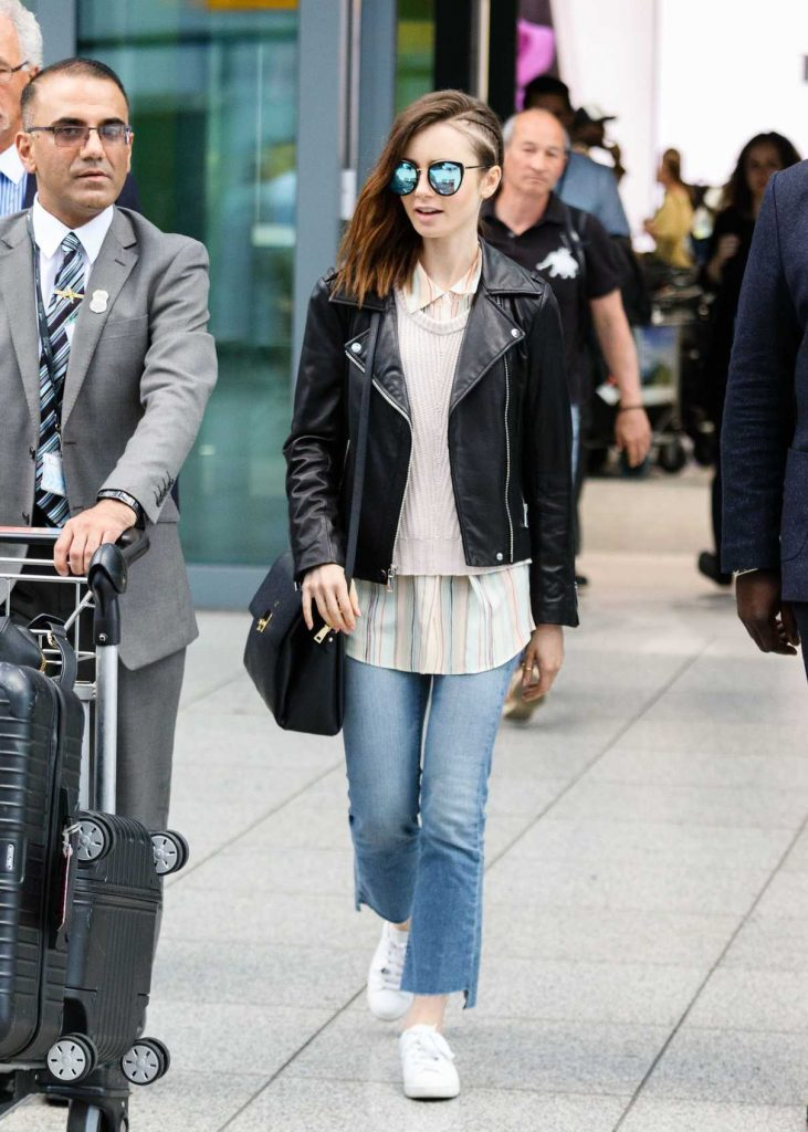 Lily Collins Arrives at Heathrow Airport in London 05/23/2017-2