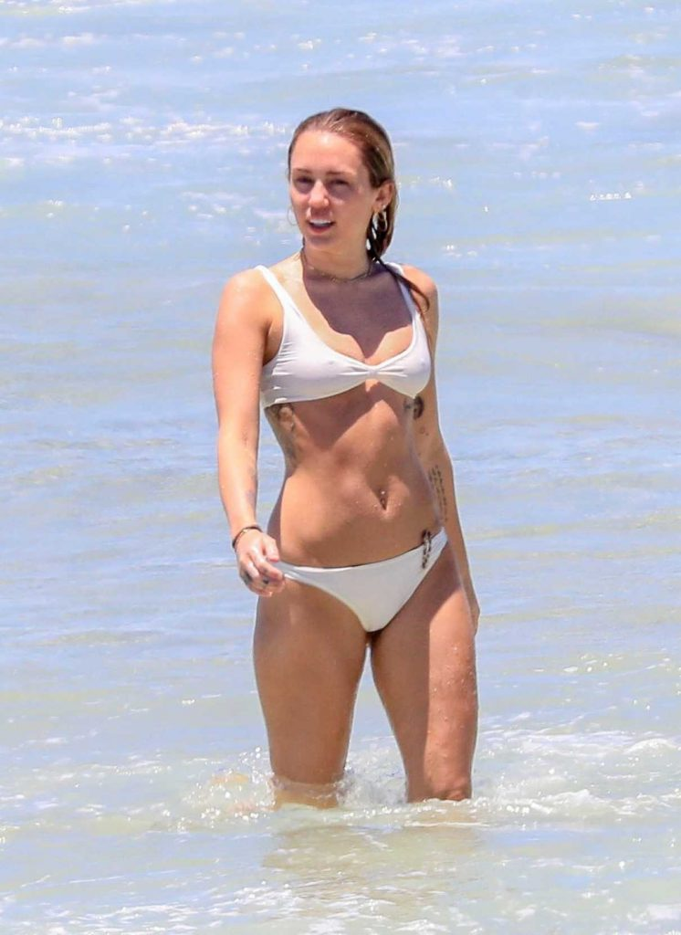 Miley Cyrus in Bikini at the Beach with Liam Hemsworth in Byron Bay, Australia 01/15/2018-1