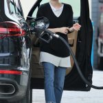 Emma Roberts Stops at a Gas Station to Fill up Her Porsche SUV in Los Angeles 03/13/2018-2