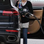 Emma Roberts Stops at a Gas Station to Fill up Her Porsche SUV in Los Angeles 03/13/2018-3