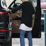 Emma Roberts Stops at a Gas Station to Fill up Her Porsche SUV in Los Angeles 03/13/2018-5