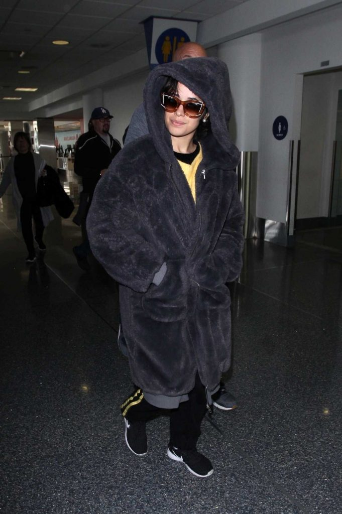 Camila Cabello Wears a Large Fur Coat at LAX Airport in Los Angeles 04/08/2018-1