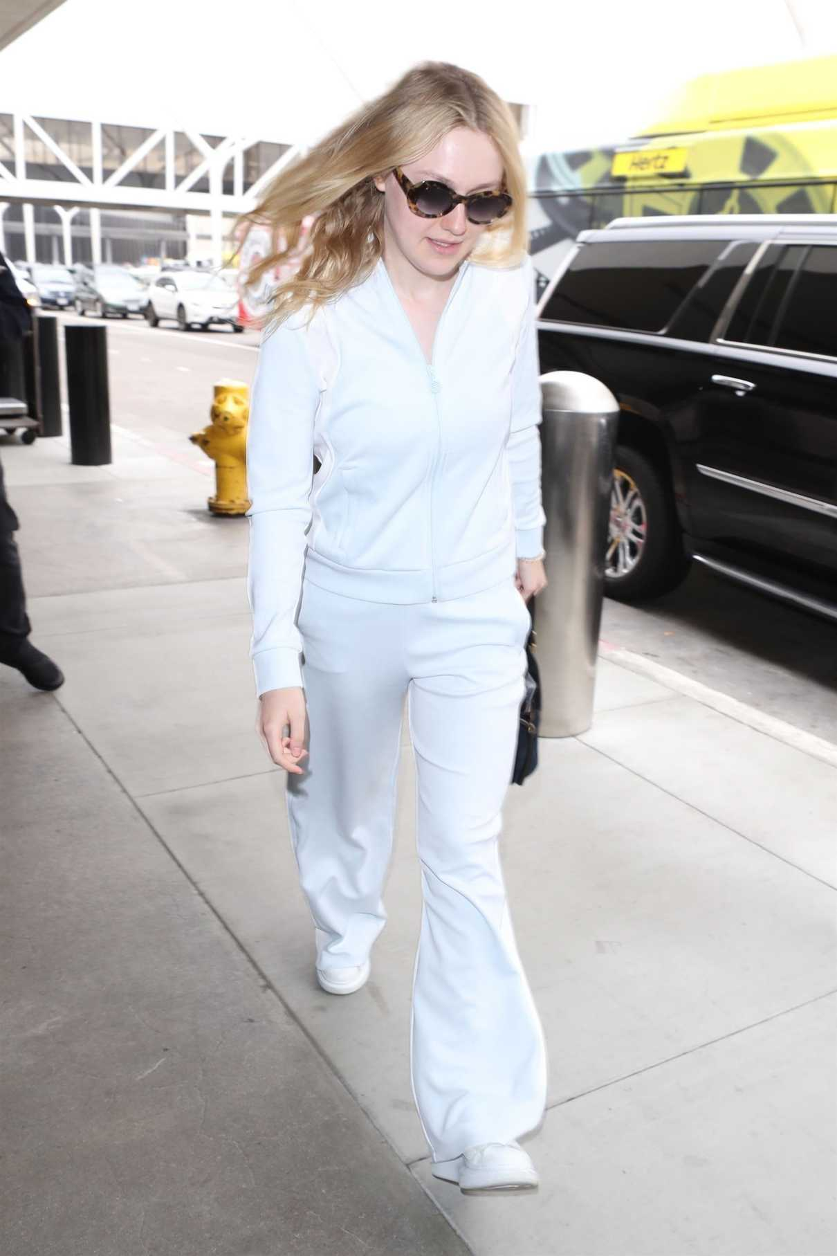 Dakota Fanning Wears All White as She Departs at LAX Airport in LA 05/24/2018-1