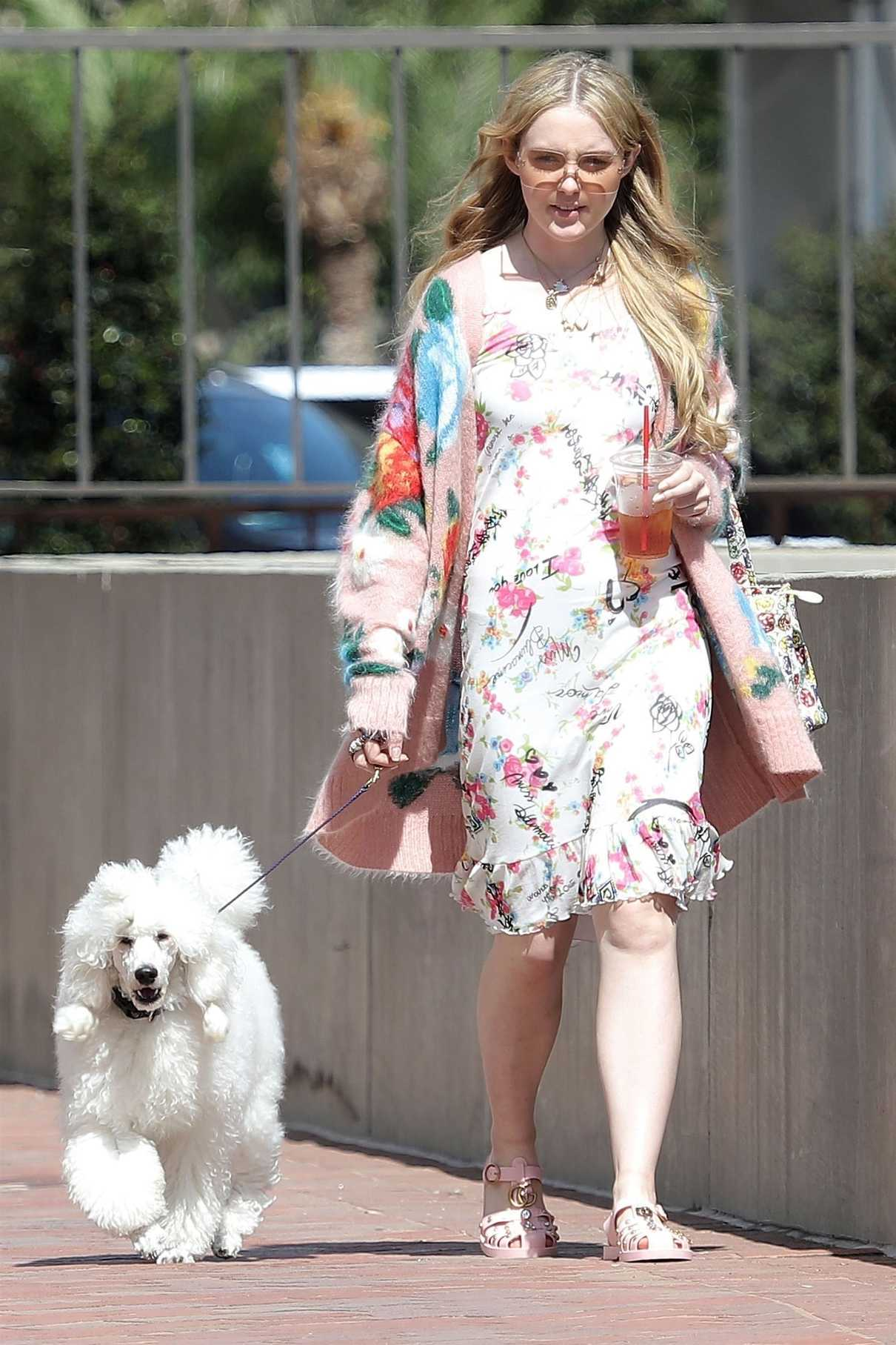 Kathryn Newton Wears a Summer Floral Dress as She Walks Her Dog in Beverly Hills 07/17/2018-3