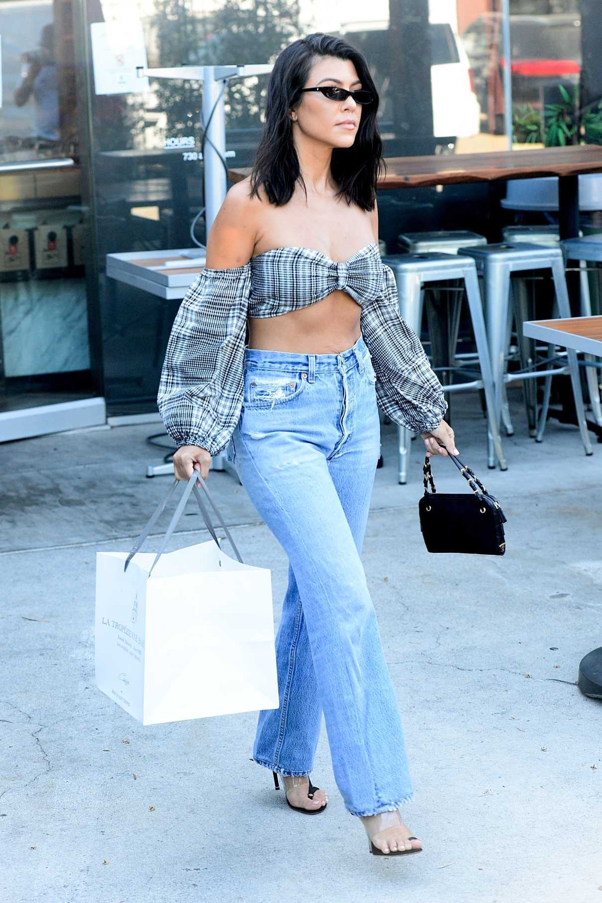 Kourtney Kardashian In A Ripped Blue Jeans Arrives At Paint