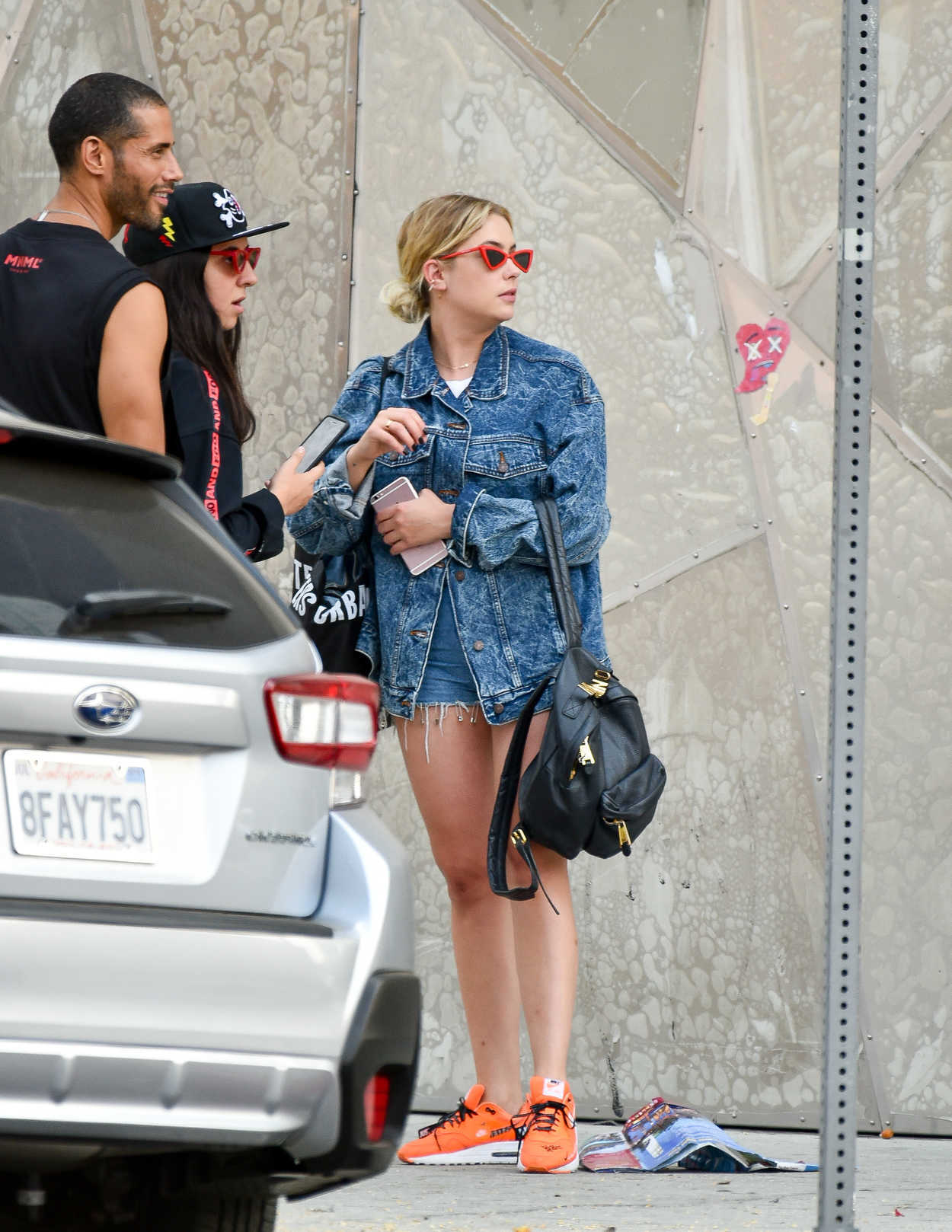Ashley Benson in an Orange Nike Trainers
