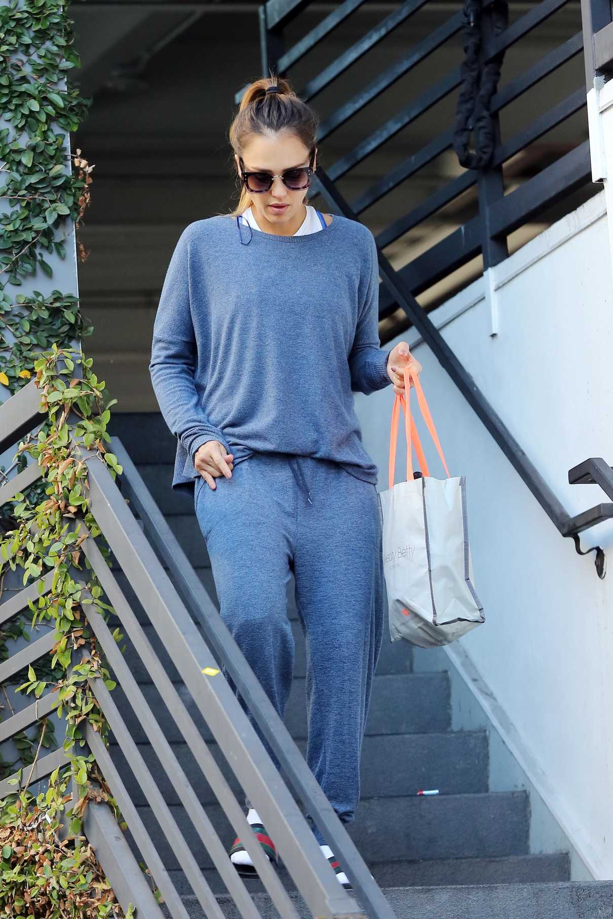 Jessica Alba in a Blue Sweatshirt