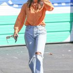 Kourtney Kardashian ia an Orange Blouse