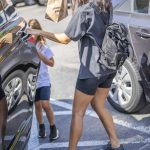 Kourtney Kardashian in a Black Spandex Shorts