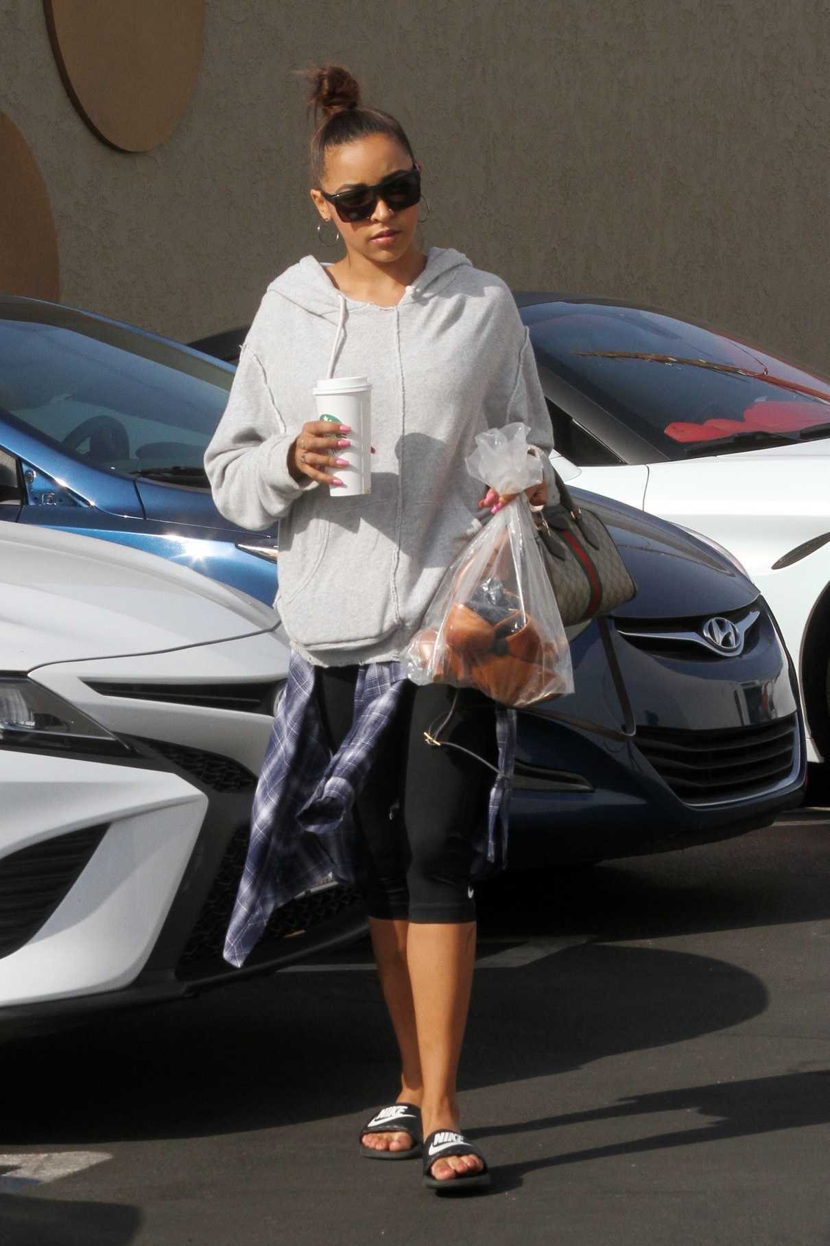 Tinashe in a Gray Hoody