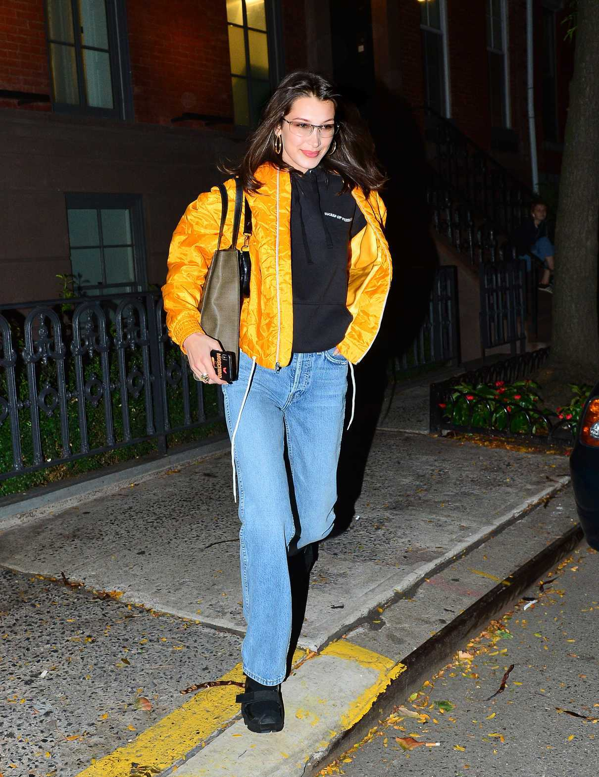Bella Hadid in a Yellow Bomber Jacket