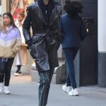 Kaia Gerber in a Black Leather Trench Coat