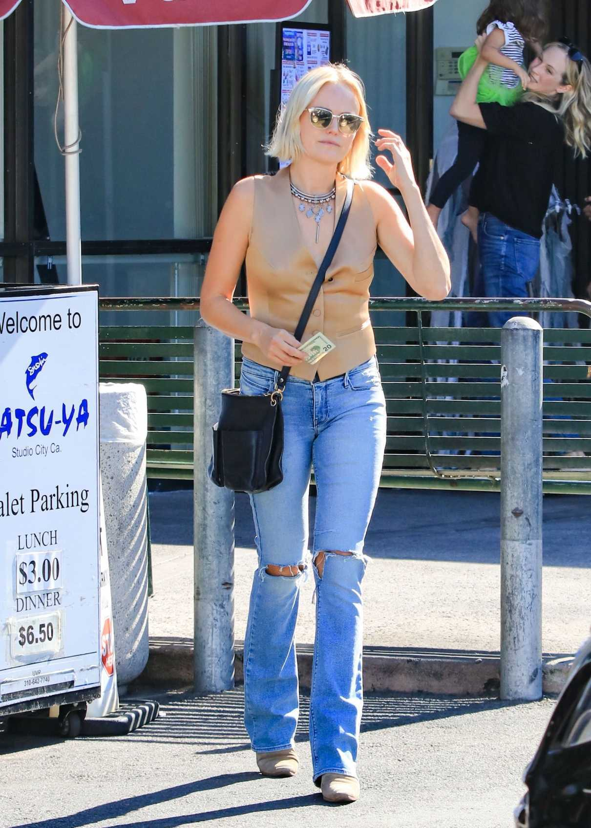 Malin Akerman in a Blue Ripped Jeans