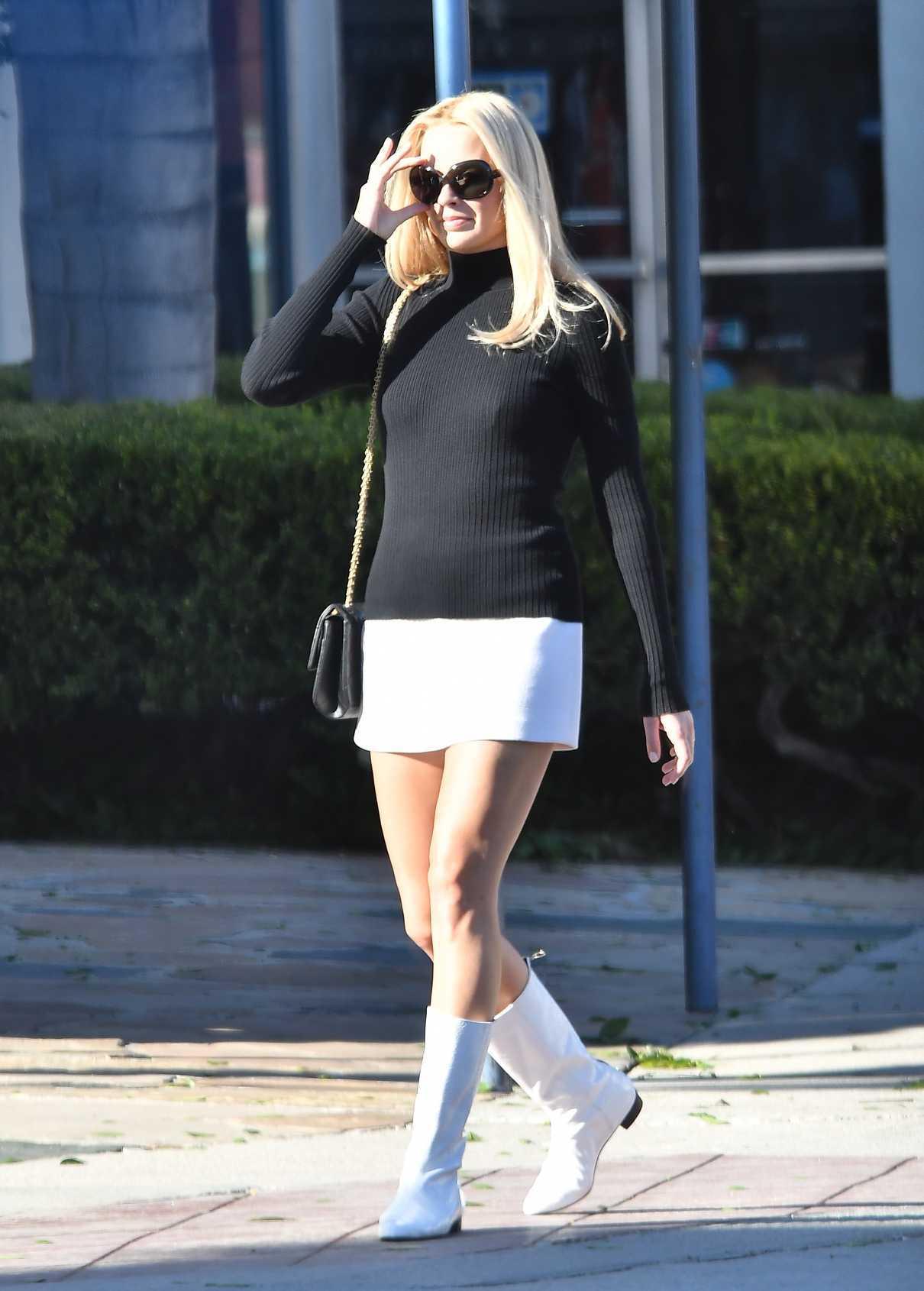 Margot Robbie in a Short White Skirt