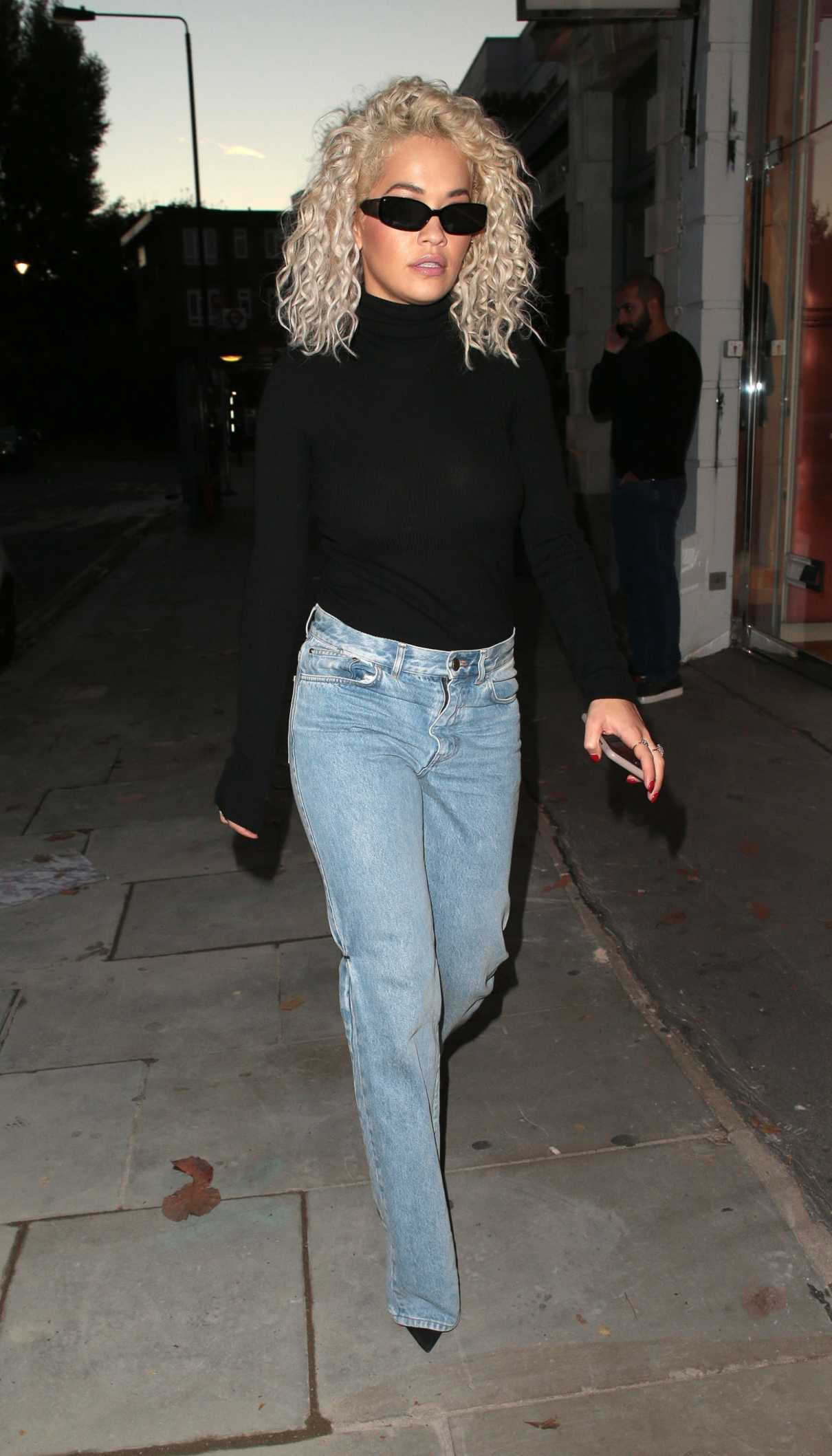 Rita Ora in a Black Turtleneck
