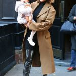 Chrissy Teigen in a Beige Trench Coat