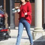 Dakota Johnson in a Red Pulover