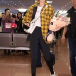 Gigi Hadid in a Yellow Plaid Jacket