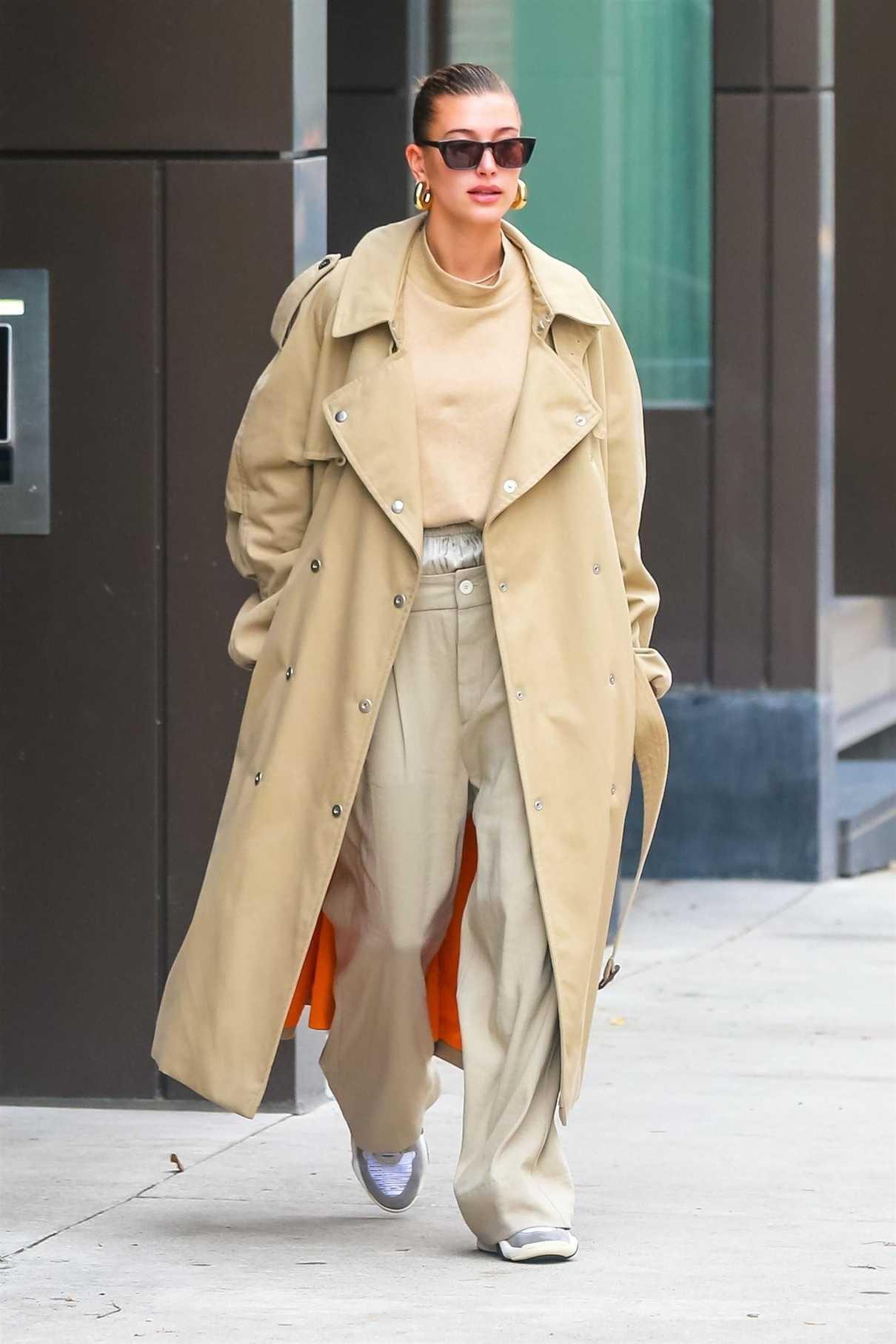 Hailey Baldwin in a Beige Trench Coat