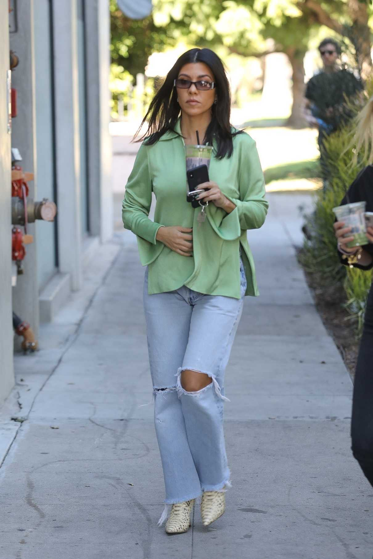 Kourtney Kardashian in a Green Blouse