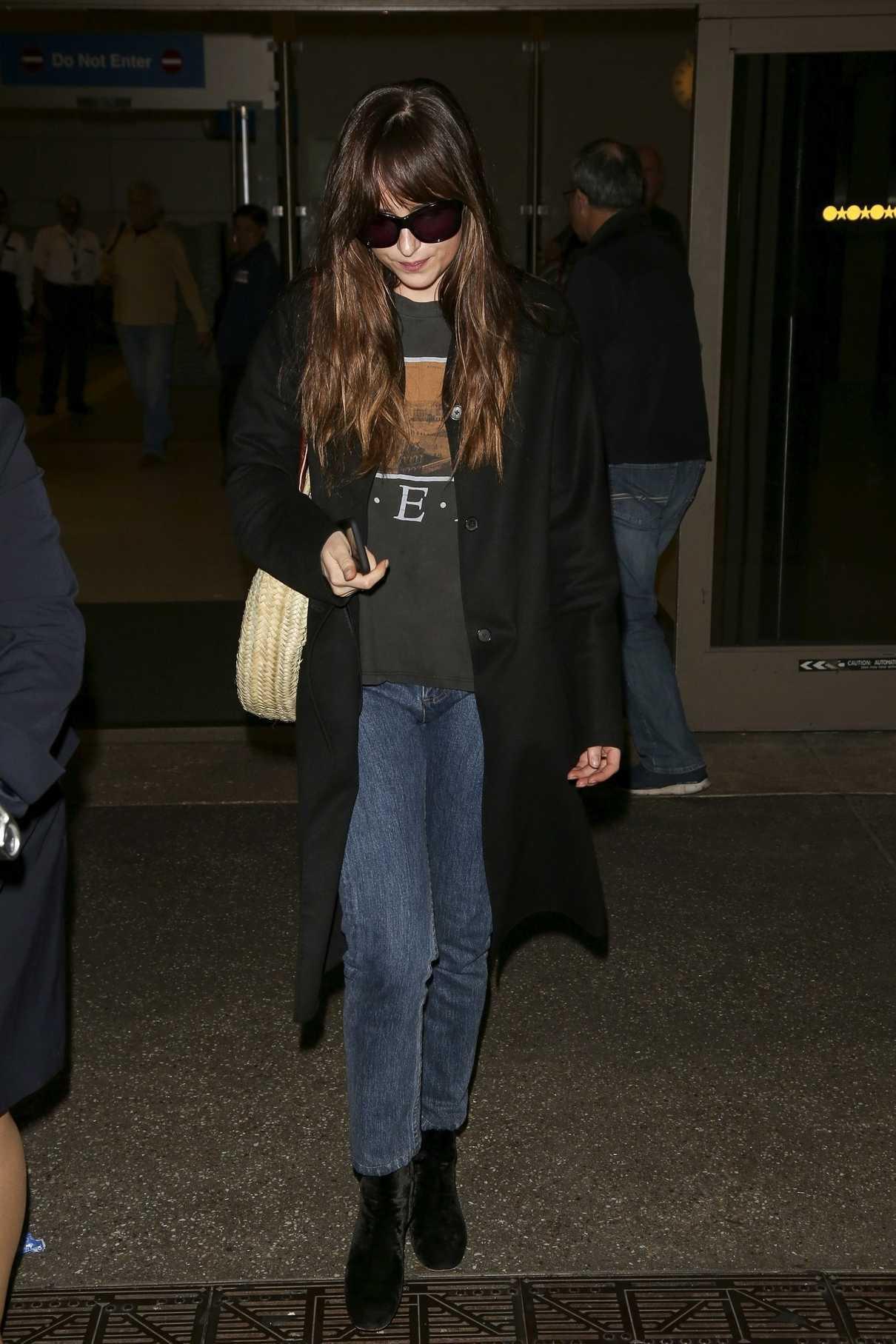Dakota Johnson in a Black Coat