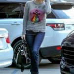 Emma Roberts in a Gray Sweater