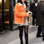 Hailee Steinfeld in a Short an Orange Sheepskin Coat