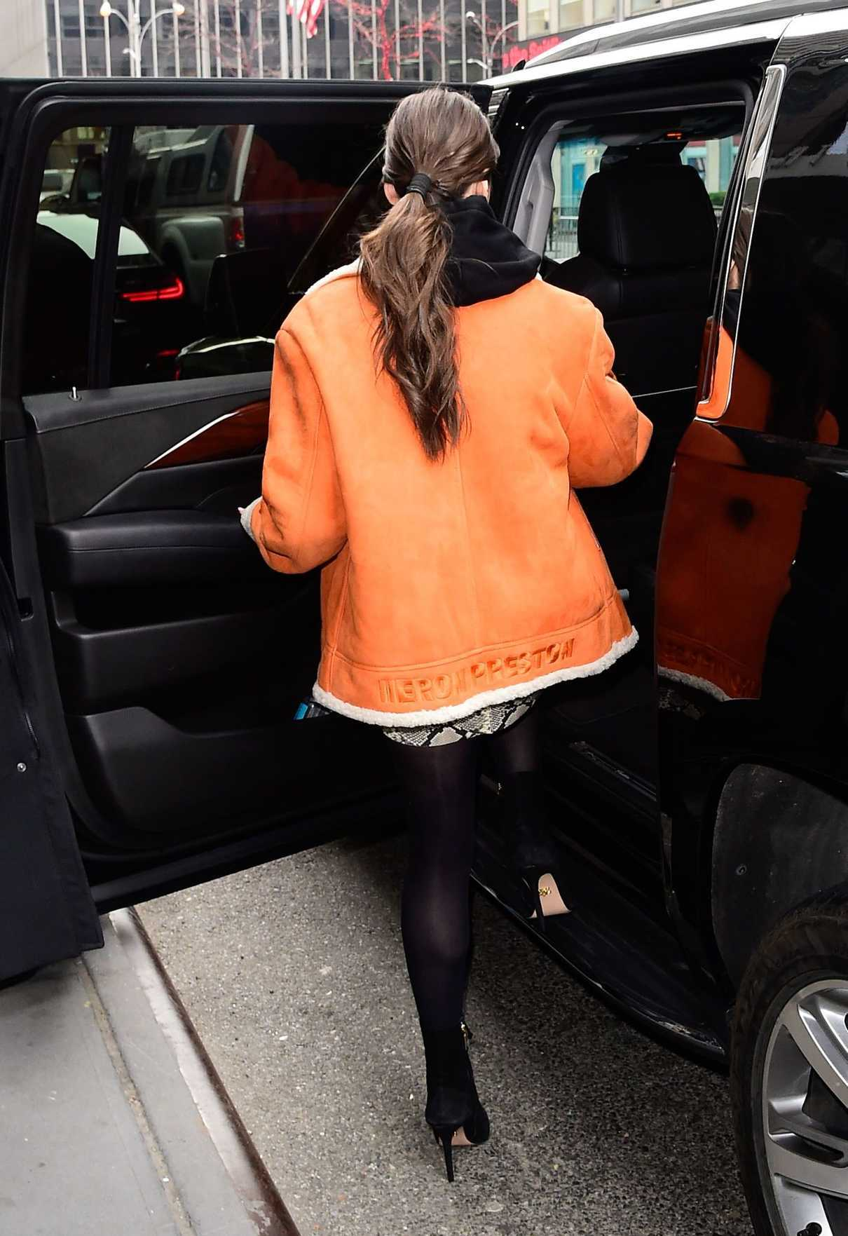 Hailee Steinfeld in a Short an Orange Sheepskin Coat