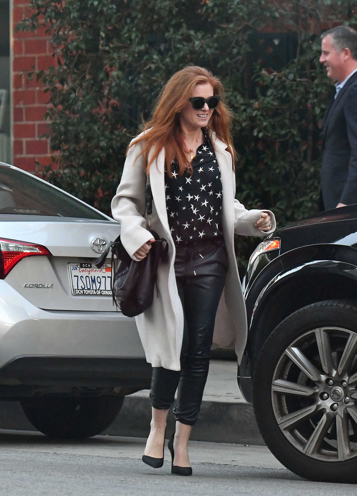 Isla Fisher in a White Coat