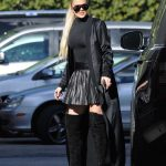 Khloe Kardashian in a Black Turtleneck