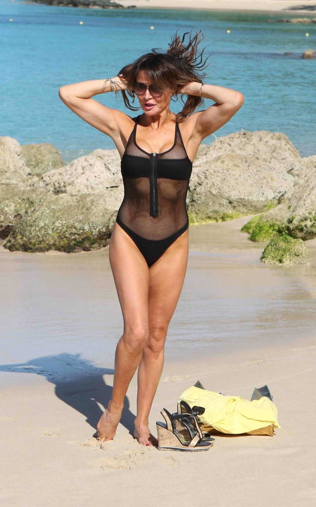 Lizzie Cundy in a Black Swimsuit