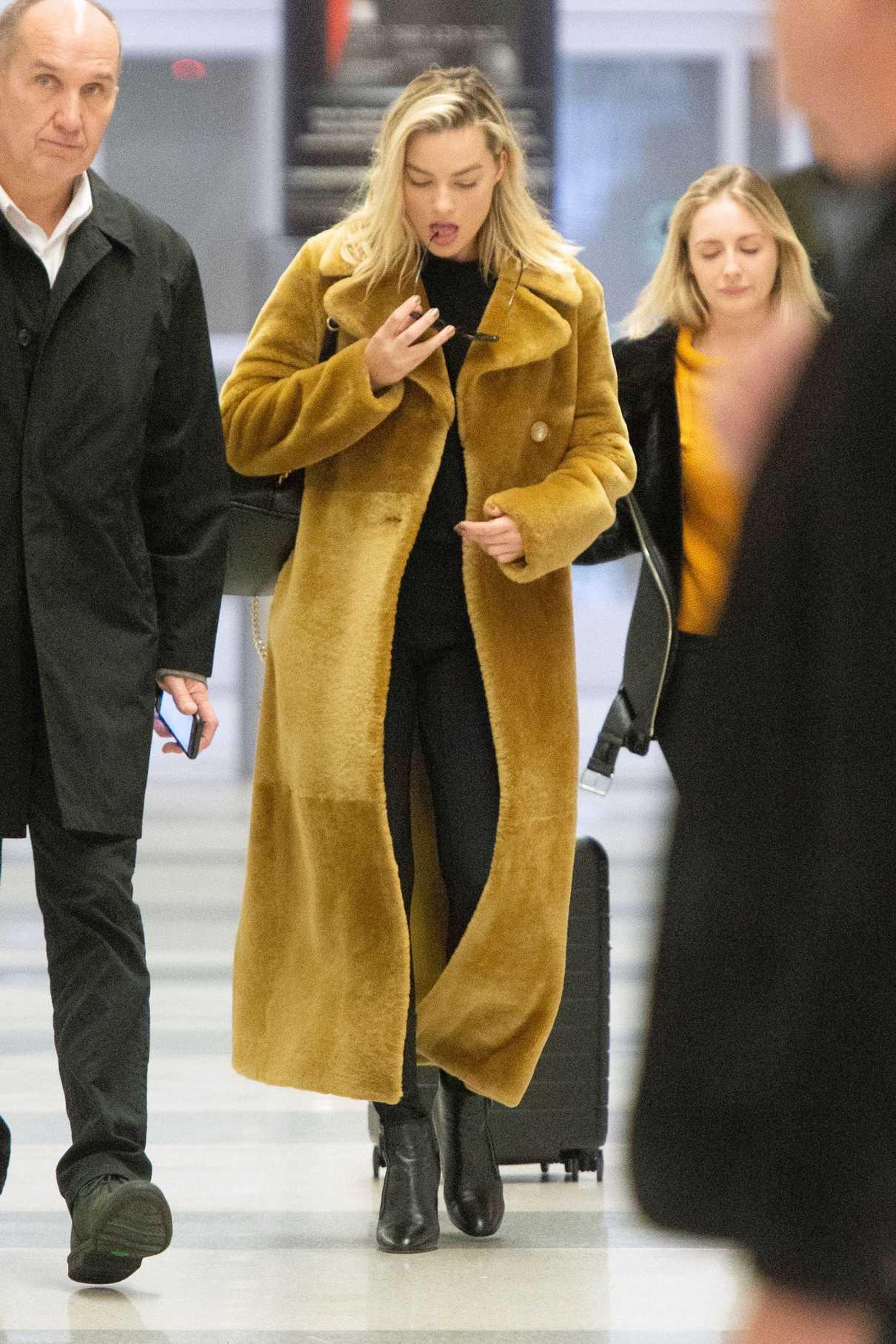 Margot Robbie in a Long Yellow Fur Coat