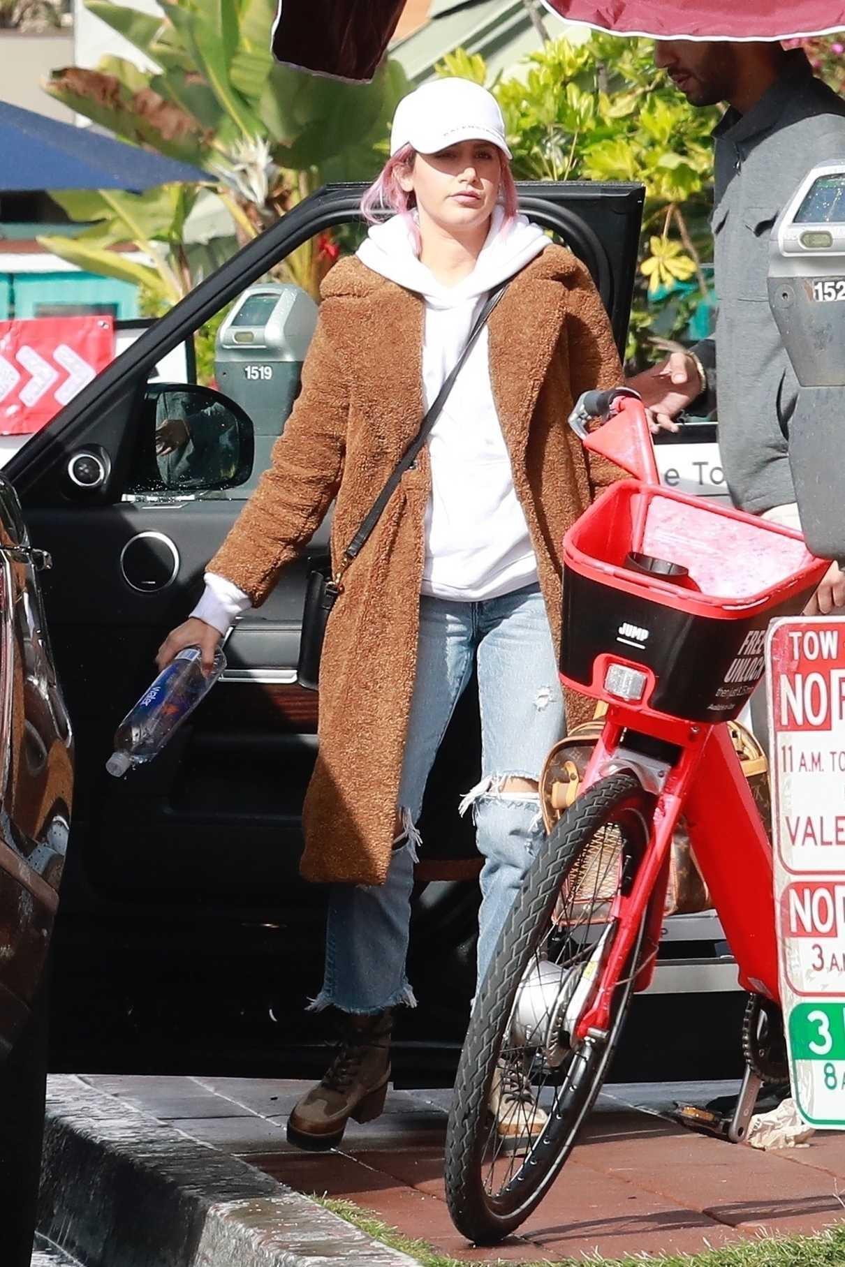 Ashley Tisdale in a Beige Fur Coat