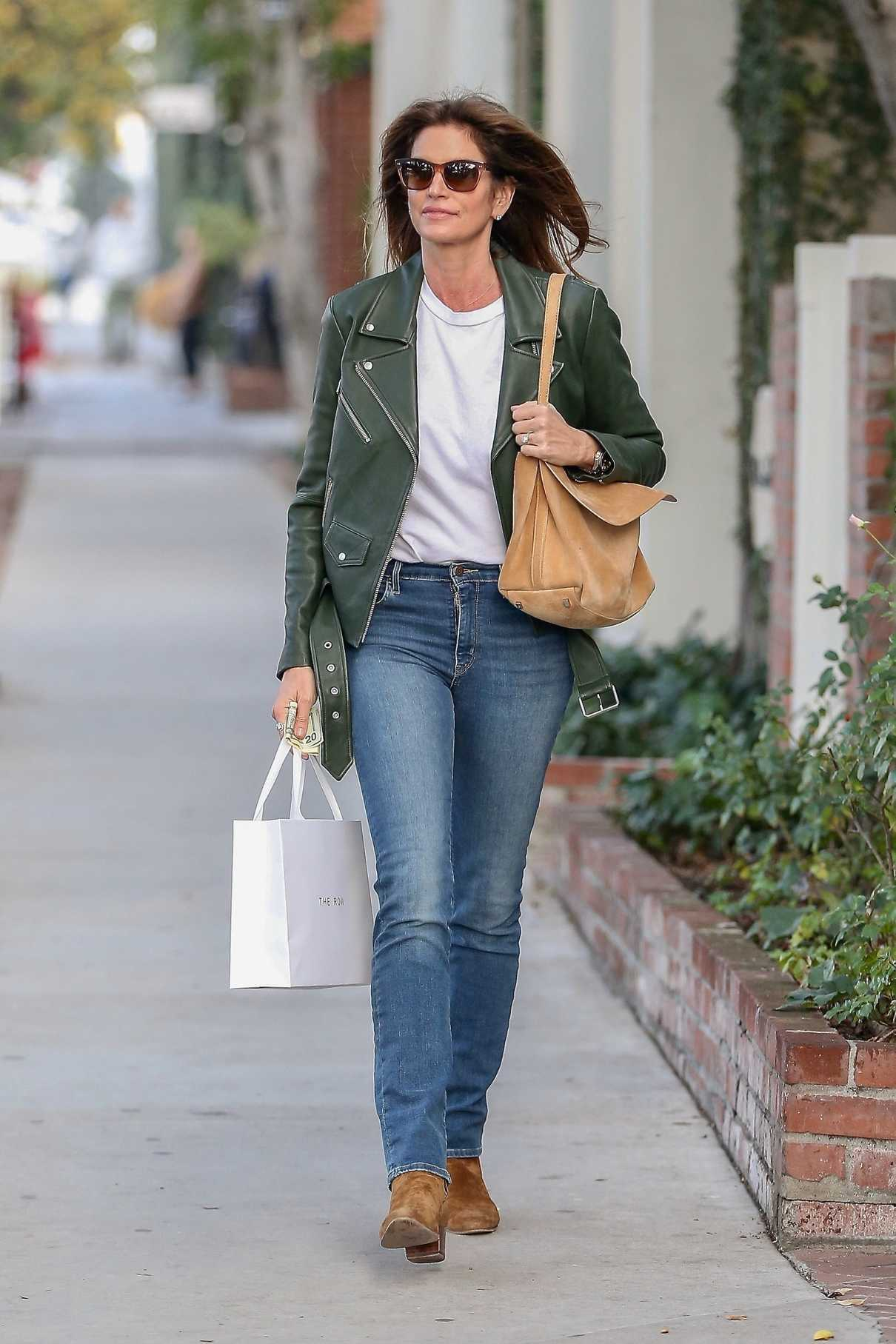 Cindy Crawford in a Green Jacket