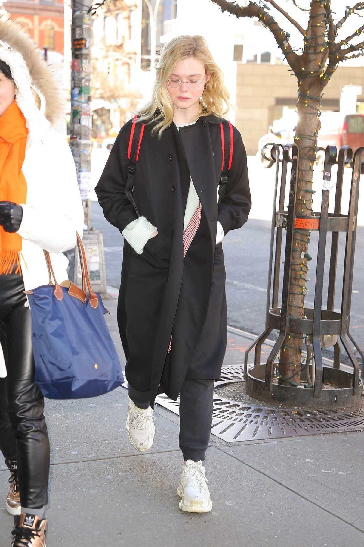 Elle Fanning in a Black Coat