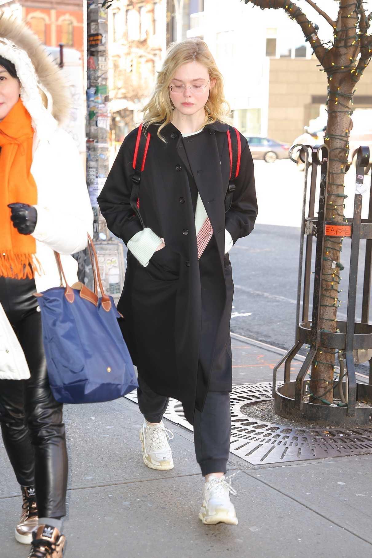 Elle Fanning in a Black Coat