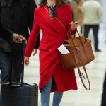 Emmy Rossum in a Red Coat