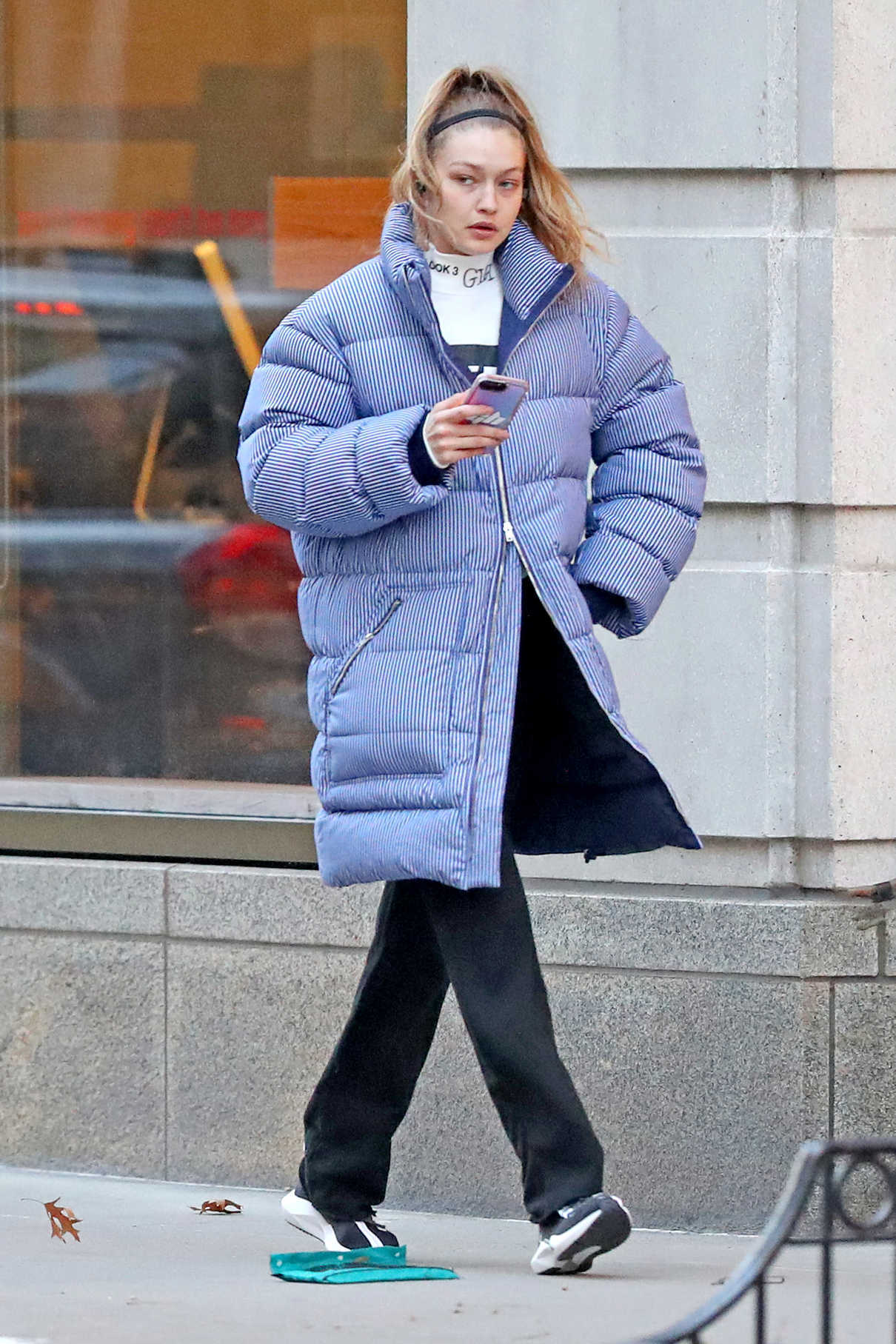 Gigi Hadid in a Pin Stripe Puffer Jacket