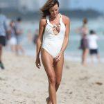 Kelly Bensimon in a White Swimsuit on the Beach in Miami 01/02/2019