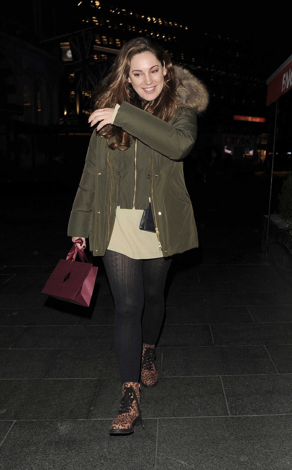 Kelly Brook in a Green Puffer Jacket