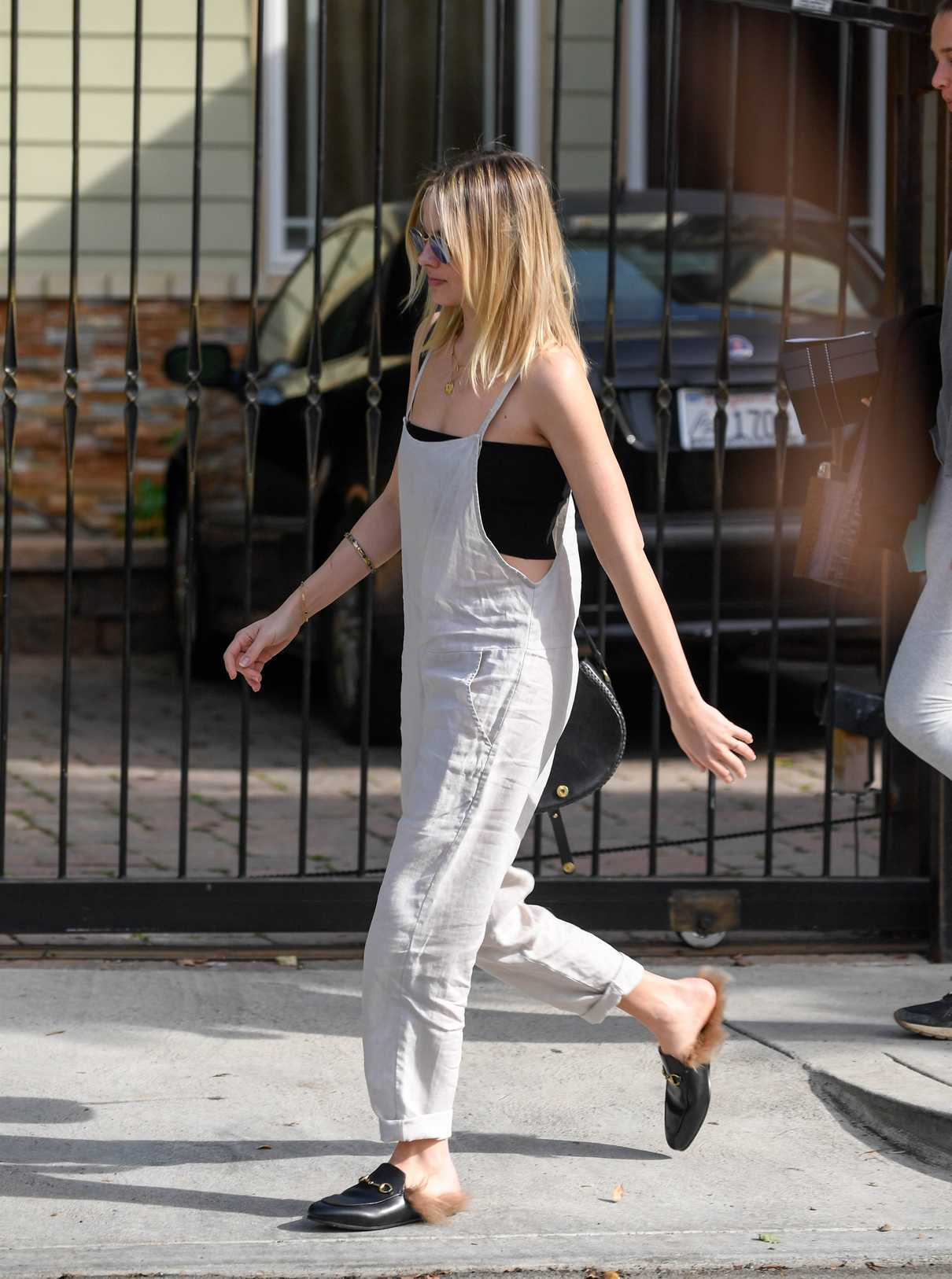 Margot Robbie in a White Overalls