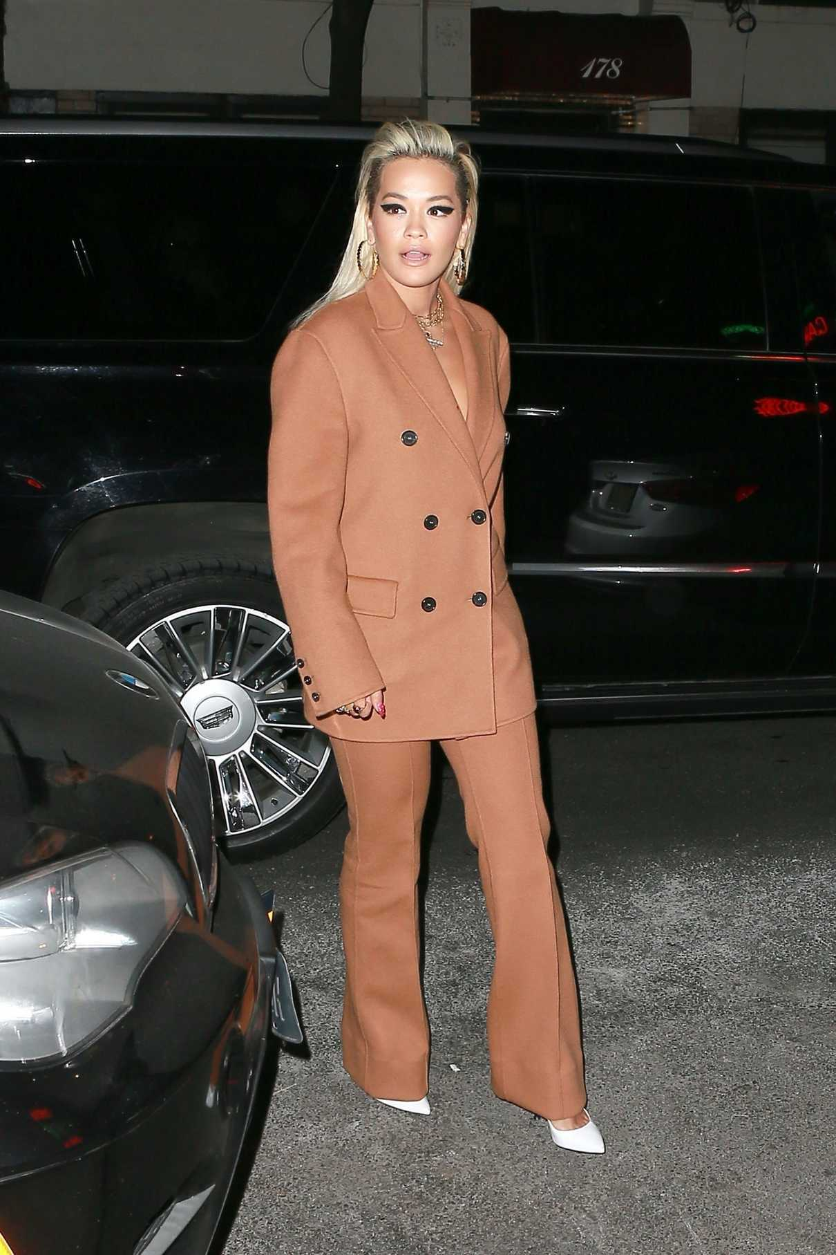 Rita Ora in a Beige Suit