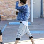 Mila Kunis in a Blue Denim Jacket