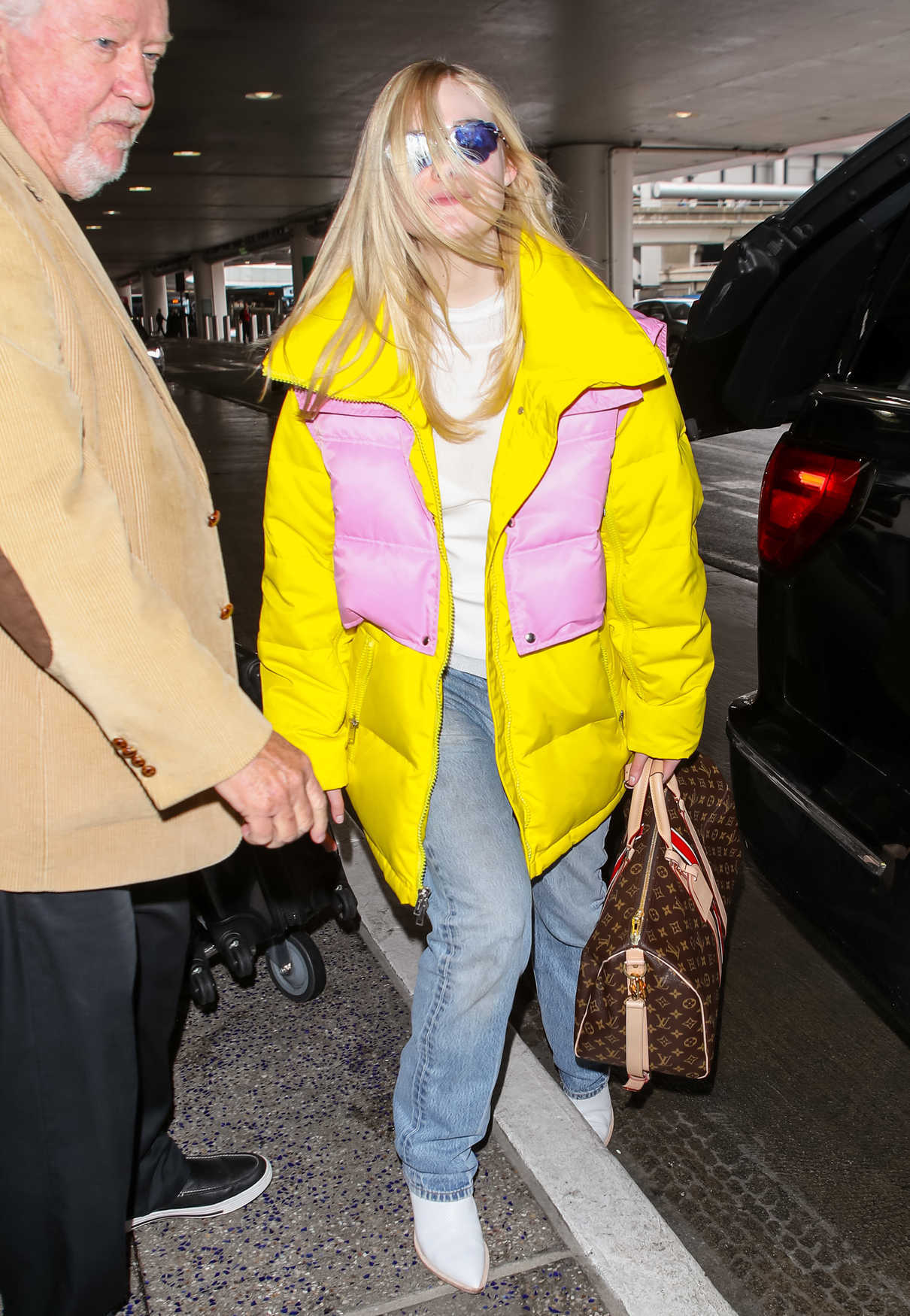 Elle Fanning in a Yellow Puffer Jacket